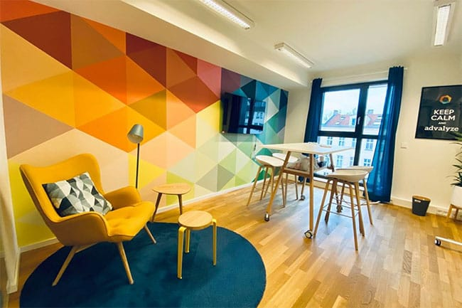 Chill-out corner with colorfull wall in the Advalyze Office